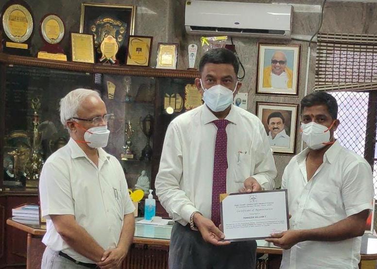 Panneer Selvam receives certificate for his extraordinary service