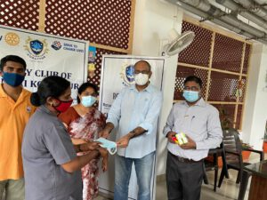 Rotary Club of Chennai Korattur distributes Masks, Refreshments and Ghee
